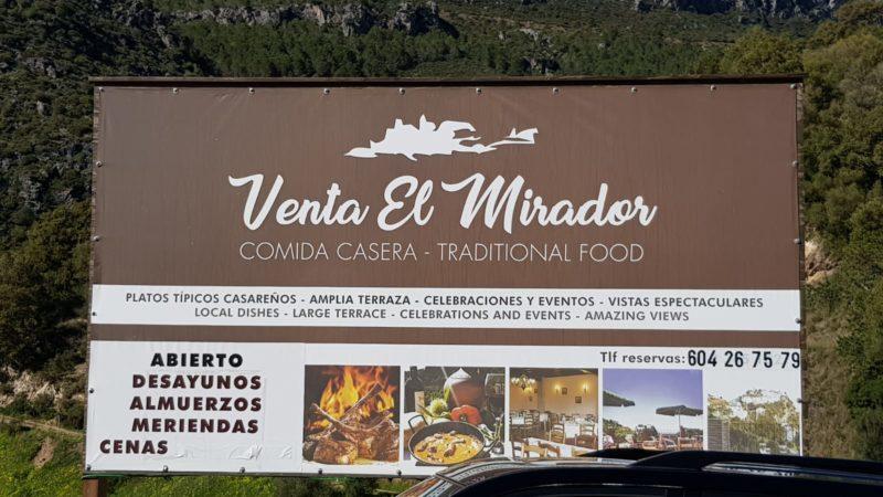 Venta El Mirador welcome sign in Casares mountains