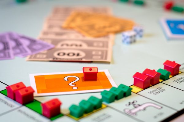 Buying property for investment - monopoly board